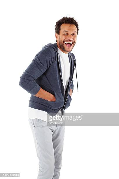 african man laughing at camera - three quarter length stock pictures, royalty-free photos & images