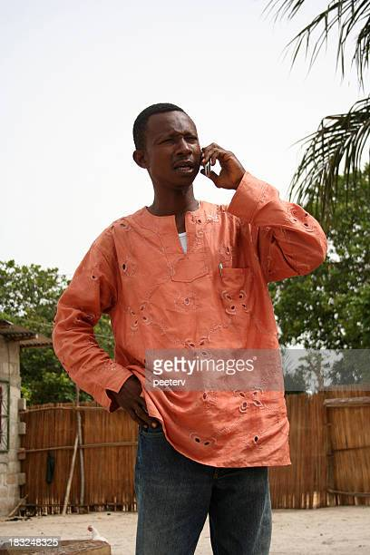 african man on the phone