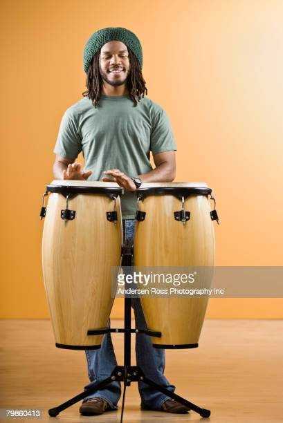 African man playing drums