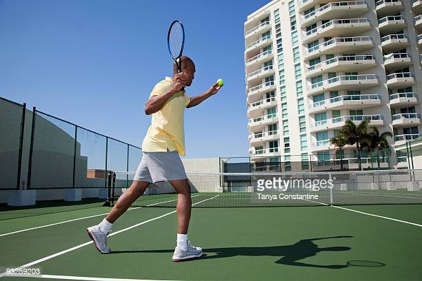 african man playing tennis - tanya constantine stock pictures, royalty-free photos & images