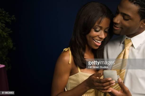 African man proposing to girlfriend