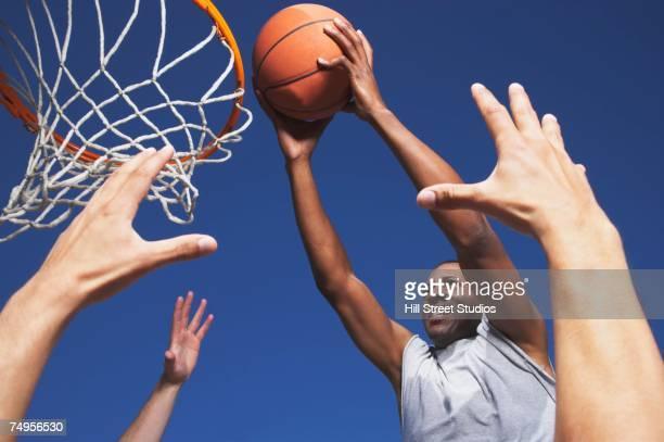 African man shooting basketball