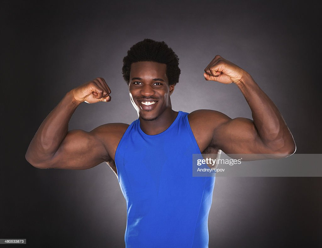 African Man Showing Muscle : Stockfoto