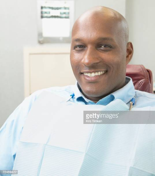 African man smiling in dentist's chair