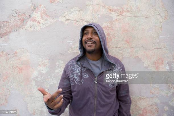 African man standing in front of wall