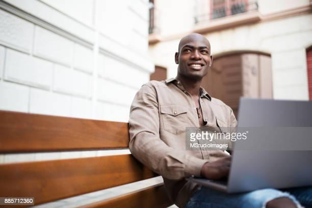 African man using laptop.