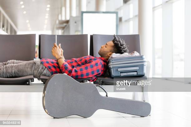 African man waiting at airport lounge