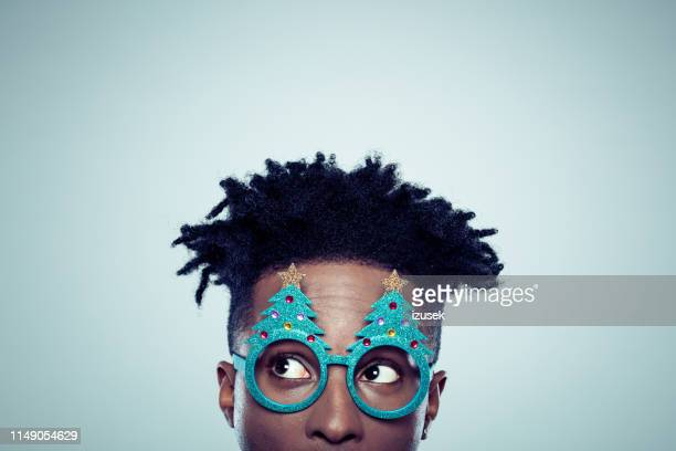 african man with christmas mask - funky stock pictures, royalty-free photos & images