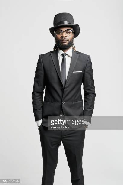 african man with dreadlocks - top hat stock pictures, royalty-free photos & images