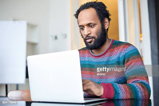African man working at his desk