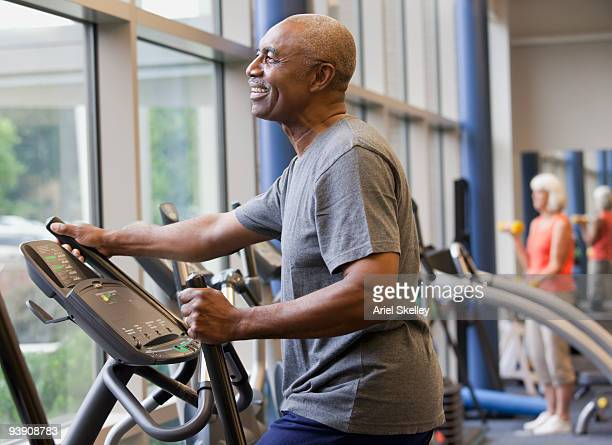 African man working out on elliptical machine