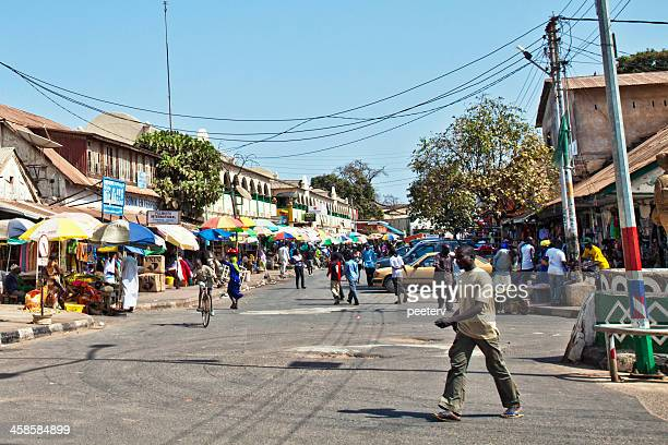 african market street. - banjul stock pictures, royalty-free photos & images