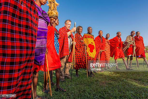 african masai people are posing with tourist man - african tribal culture stock pictures, royalty-free photos & images