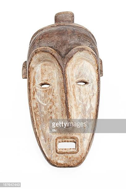 african mask isolated on white background - sculptuur stockfoto's en -beelden