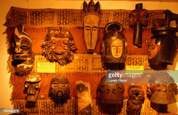 african masks at museo d'arte e scienza at via quintino sella. - arte stock pictures, royalty-free photos & images