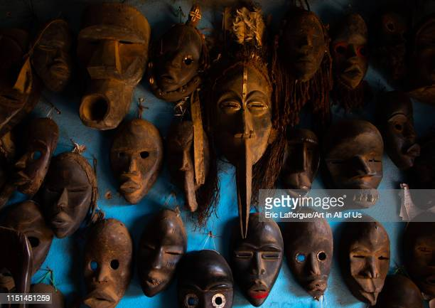 African masks for sale in a shop, Tonkpi Region, Man, Ivory Coast on May 6, 2019 in Man, Ivory Coast.