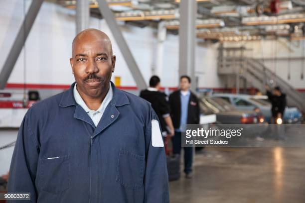 African mechanic in auto body shop