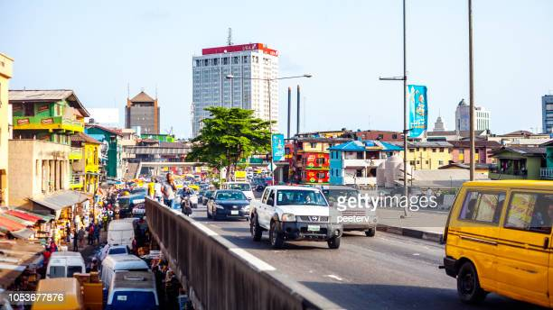african megacity traffic - lagos, nigeria - lagos nigeria stock pictures, royalty-free photos & images