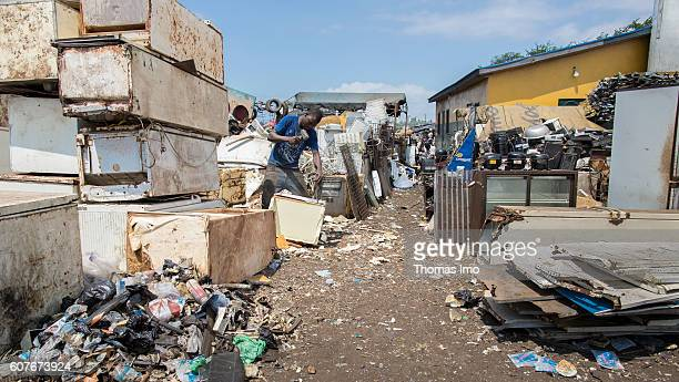 African men disassemble electronic scrap and bulky waste on the largest electronic scrap yard of Africa in Agbogbloshie a district of Ghana's capital...