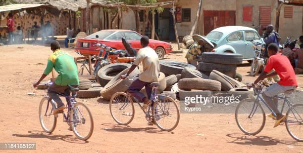 african men riding bicycles - only men stockfoto's en -beelden