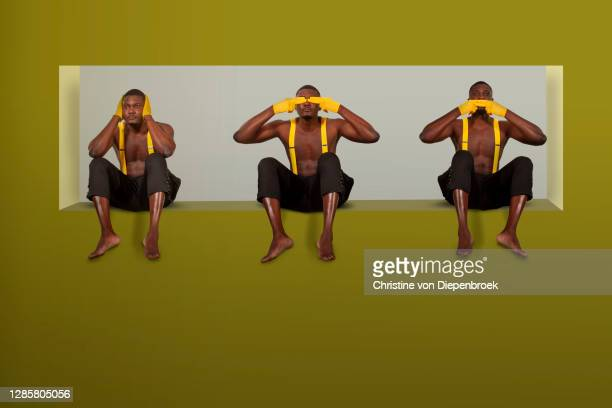 african men sitting in a window - alternative pose stock pictures, royalty-free photos & images