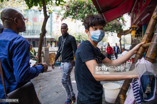 African men walk near Little North Road, part of an ethnically diverse quarter of Guangzhou known as Little Africa on February 3, 2019 in Guangzhou,...
