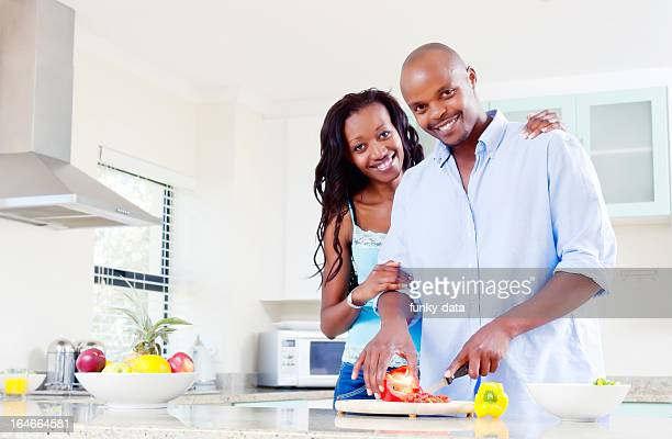 African middle class urban couple in the kitchen
