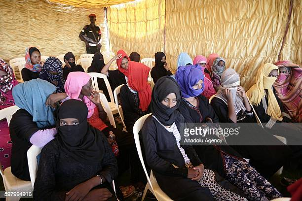 African migrants are being displayed by the security forces during a meeting over human trafficking at the defense ministry building in Khartoum...