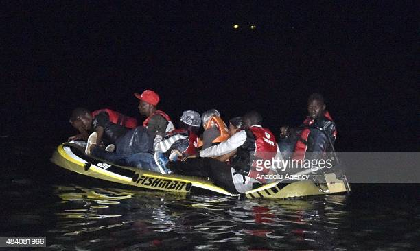 African migrants are seen after their inflatable boat took on water as they are trying to reach Greece's Kos Island from Mugla's Bodrum District on...