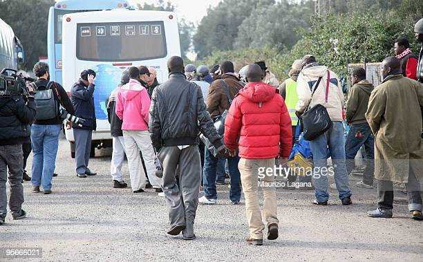 African migrants arrive to be evacuated by bus to Crotone after two days of riots during which 37 people were injured and cars were set alight on...