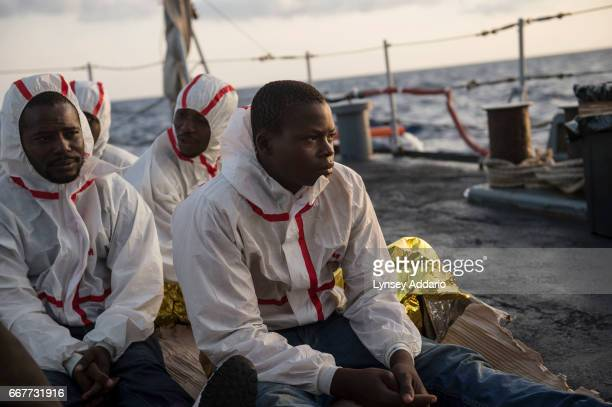 African migrants from Mali Senegal Ivory Coast and Nigeria who were rescued by a commercial ship and then transferred to the Uraniam Navy Ship wake...