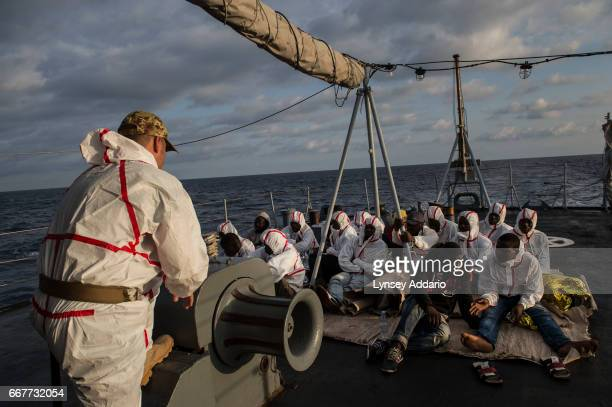 African migrants from Mali Senegal Ivory Coast and Nigeria who were rescued by a commercial ship and then transferred to the Uraniam Navy Ship ride...