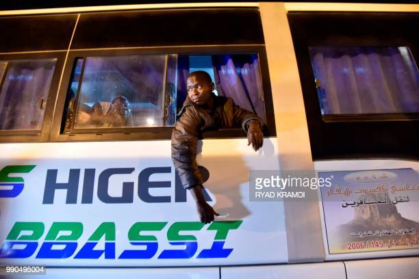 African migrants from Niger are seen in a bus as they are repatriated to their country by Algerian authorities on July 2 2018 at a transit centre for...