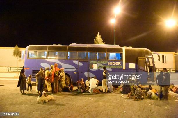 African migrants from Niger prepare to board buses as they are repatriated to their country by Algerian authorities on July 2 2018 at a transit...
