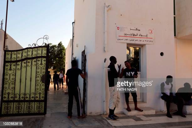 African migrants gather at a migrant centre in the south eastern town of Medenine on August 28 2018 The facility is the only one in Tunisia to host...