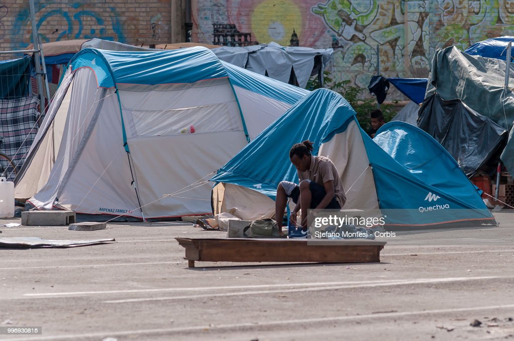 African migrants in the makeshift camp for migrants and refugees on July 12, 2018 in Rome, Italy. About three hundred African, Kurdish and Eritrean migrants live in the Baobab migration centre, a makeshift camp of about 200 tents and shacks near Tiburtina train station without water, electricity and toilets.