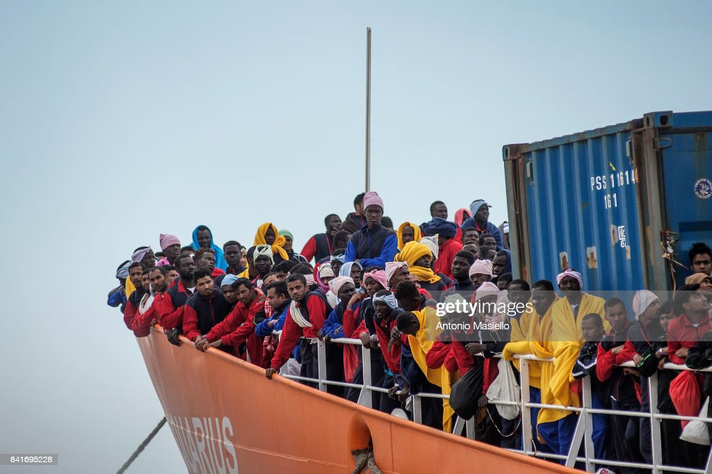 African migrants landing in the port of Salerno aboard the 'Aquarius' ship of the Ngo 'SOS Mediterranee' on May 26, 2017 in Salerno, Italy. On board also 193 unaccompanied minors and 21 pregnant. During to the G7 Taormina summit Sicily ports are closed and landings suspended for safety reasons.