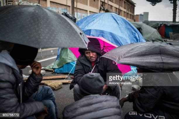 African migrants live in the makeshift camp for migrants and refugees despite the low temperatures during the winter season in Rome Italy on February...