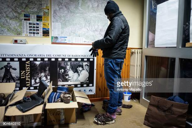 African migrants prepare to spend the night in the railway station on January 13 2018 in Bardonecchia Italy With the the closure of the French border...