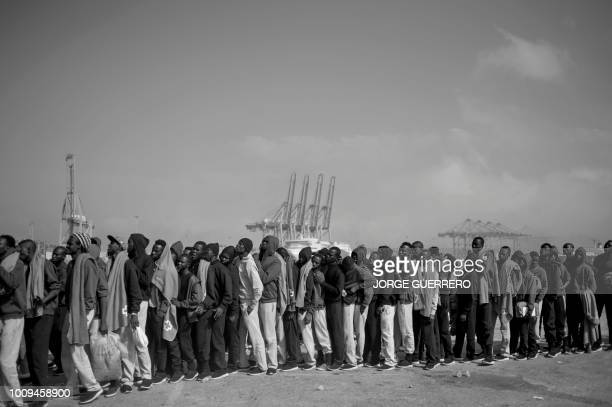 African migrants rescued at sea queue as they wait for being transferred at the harbour of Algeciras on August 1 2018 Spain has overtaken Italy as...