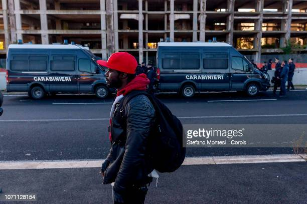 African migrants stay outside stand outside the building during the evacuation of a former penicillin factory where migrants from Africa but also...