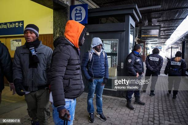African migrants wait a train for Turin at the railway station on January 14 2018 in Bardonecchia Italy With the the closure of the French border in...