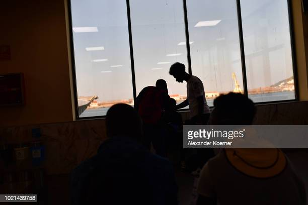 African migrants wait to board a ferry towards Algeciras the Spanish mainland on August 22 2018 in Ceuta Spain After a period of six to twelve months...