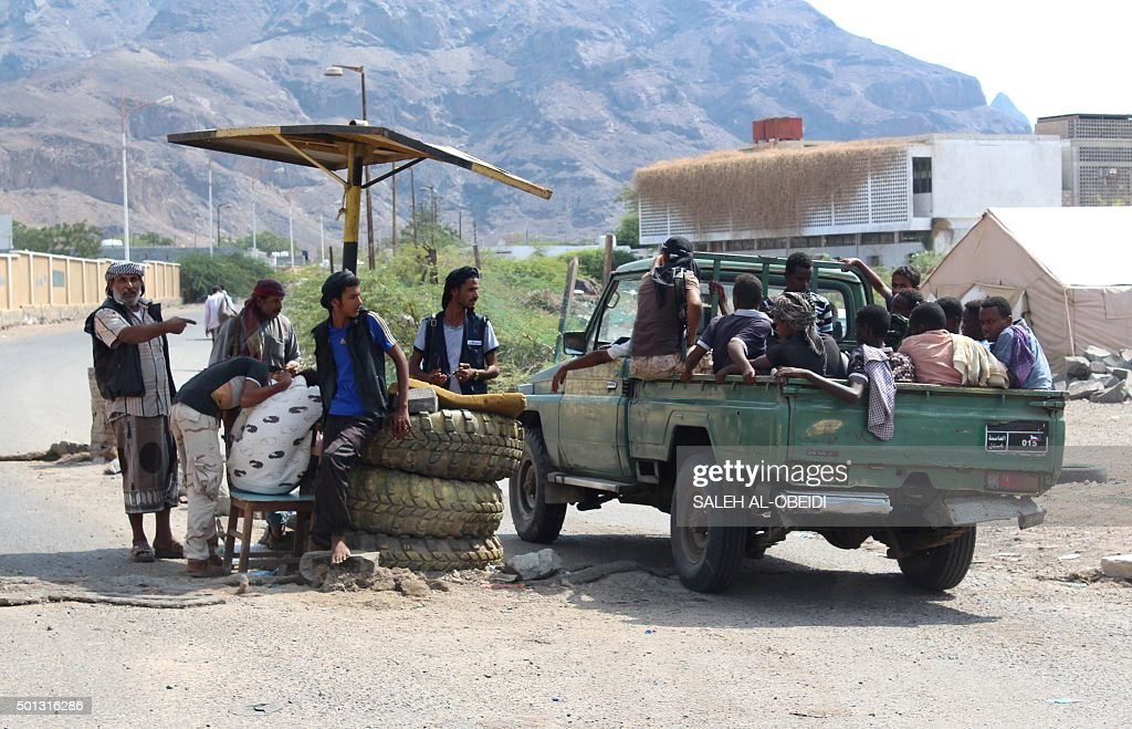 African migrants who were reportedly smuggled by sea into Yemen, sit on the back of a vehicle after they were detained by Yemeni fighters loyal to Yemen's President Abedrabbo Mansour Hadi, on the outskirts of the city of Aden, on December 14, 2015.
