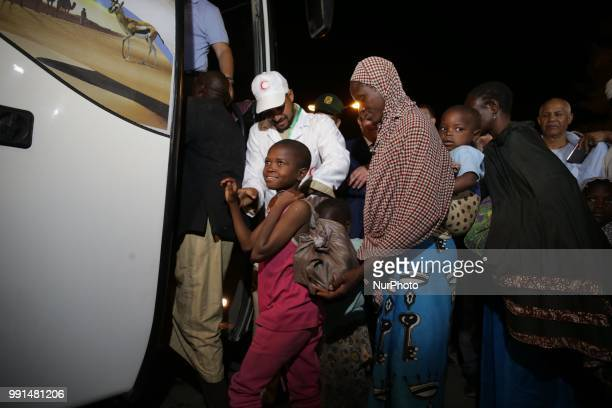 African migrants who will be repatriated to their country by the Algerian government from the temporary refuge center near the Niger border in...