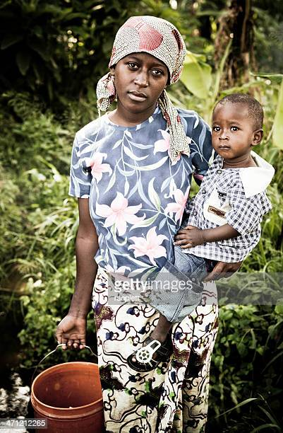 African Mother & Child Gathering Water