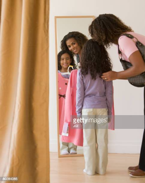 African mother and daughter clothing shopping