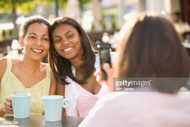 African mother and daughter having photograph taken