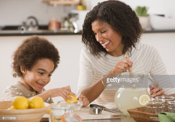 African mother and son making lemonade