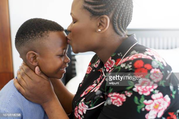african mother dressing son for school moments i love and care for you kiss - i love you stock pictures, royalty-free photos & images